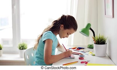 happy girl drawing at home - people, children, creativity...