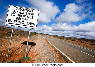 Outback Road Sign - Road sign in the Australian outback,...
