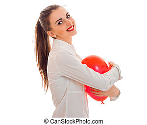 young beautiful girl with red lipstick is holding a balloon and smiling