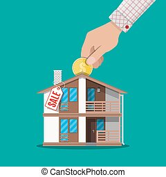 Hand put coin in piggy bank house