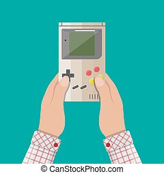Old Gadget. Handheld game console in hands - Hands holds old...