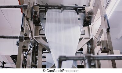 Printing establishment detail on production line with sound....