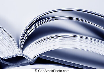 Open Book - Open text book, in blue tone Soft focus, shallow...