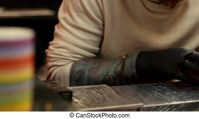 Tattoo Artist Working Close Up - First class stamp on the...