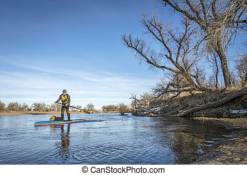 Expedition winter stand up paddling on South Platte RIver -...