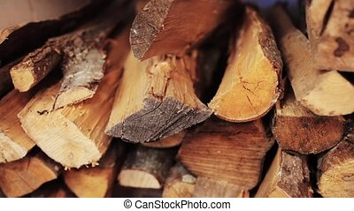 stack of firewood - stove heating and wood fuel concept -...