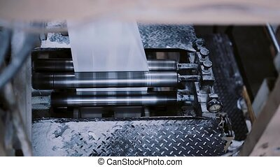 A view of process of printing at a printing establishment. Paper in a printing detail on production line with sound.