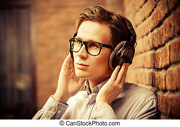 melancholy mood - Happy young man listens to music in...