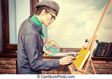 bright impression - Inspired artist man draws a picture in...