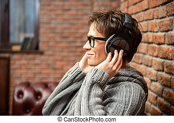 young man and music - Happy young man listens to music in...