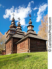 Ukrainian historical country wood church on autumn glade