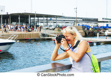 Woman photographs on the quay