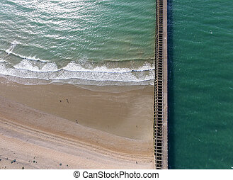 Breakwater - Aerial shot of breakwater and beach with a...