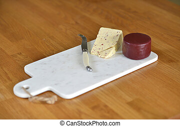 Cheese board - White marble cheese board in a kitchen with...