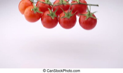 Several Ripe Tomatoes are Falling on the Table.
