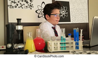 Young boy making science experiments - Portrait of a male...