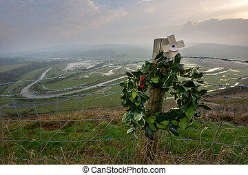 Wreath and memorial overlooking a meandering river