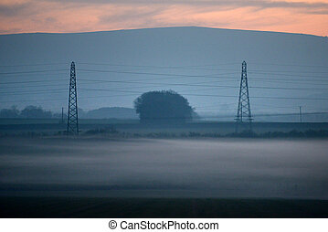 Pylons - Electricity pylons at dusk with low lying mist