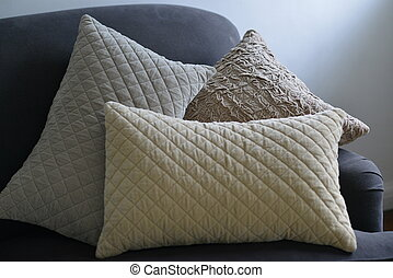 Cushions - Three textured cushions on a grey/blue couch