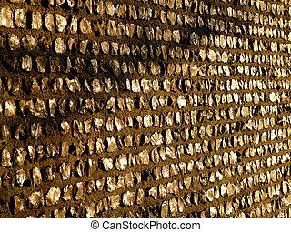 a Knapped flint wall in warm sunlight