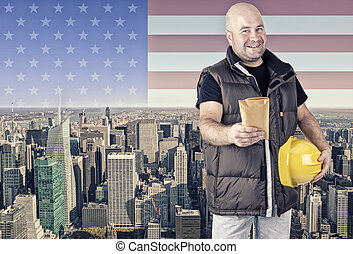 Construction worker, New York city in background.
