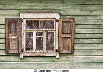 Old wooden wall with a window