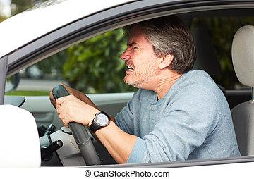 Angry nan driving car - angry irritated man driving car....