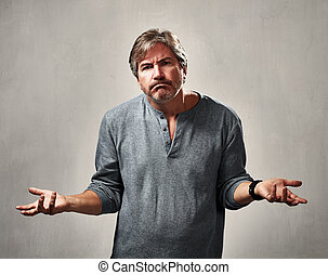 frustrated man - frustrated depressed man portrait over gray...