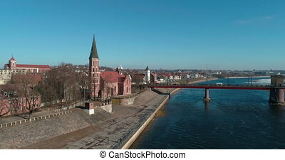 AERIAL. Smooth flight around Vytautas the Great church in Kaunas, Lithuania on sunny spring day