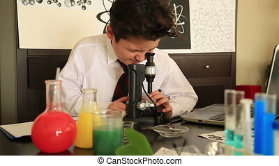 Elementary school boy studying chemistry - Cute School...