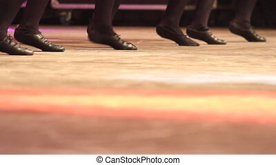 Women dancing Irish dance on stage with traditional step...