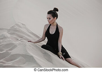 Fashion asian woman model posing in luxury dress in desert -...