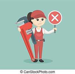 female plumber holding false sign and giant pipe wrench