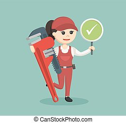 female plumber holding true sign and giant pipe wrench
