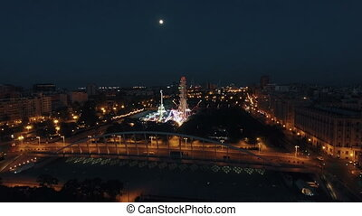 Aerial shot of night Valencia with amusement park - Aerial...