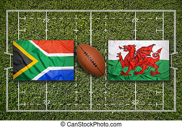 South Africa vs. Wales flags on rugby field
