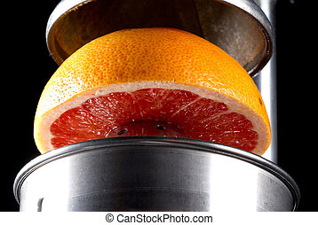 Juicer - Fresh grapefruit about to be juiced for breakfast
