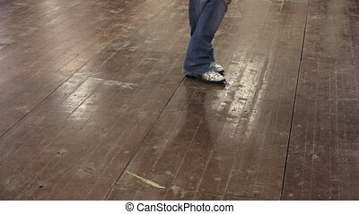 Man teach line dance at country festival with cowboy boots -...
