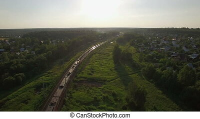 Flying over train in the countryside, Russia