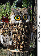 Souvenir owl made from pine cones on the Flower Show in...