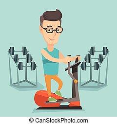 Man exercising on elliptical trainer. - Caucasian man...