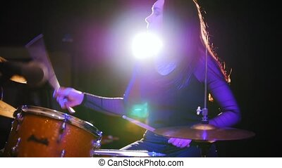 Passionate girl with long hair - percussion drummer perform...