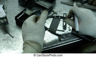 manufacture of molds for leather shoes - closeup - Sewing...