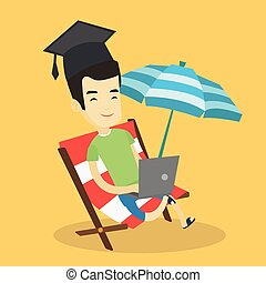 Graduate lying in chaise lounge with laptop. - Asian...