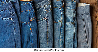 Selection of different color jeans - Selection of different...