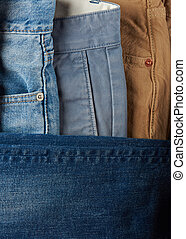 Close up of jeans stack blue and brown color