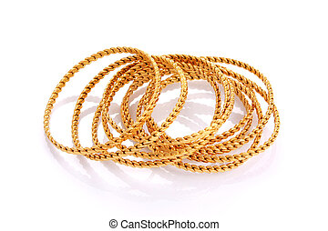 Gold bracelets isolated on white background with reflection