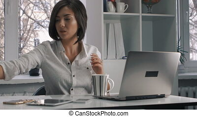 Busy multitasking attractive businesswoman in the office,...