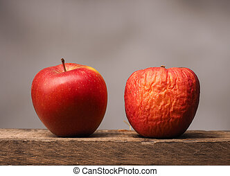 Two red apples on table - Two red apples on a rustic wooden...