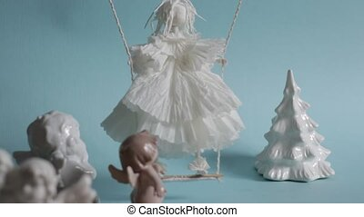 Little winged angel cherub learns to fly animation stop motion